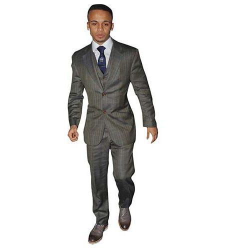A Lifesize Cardboard Cutout of Aston Merrygold wearing a grey suit