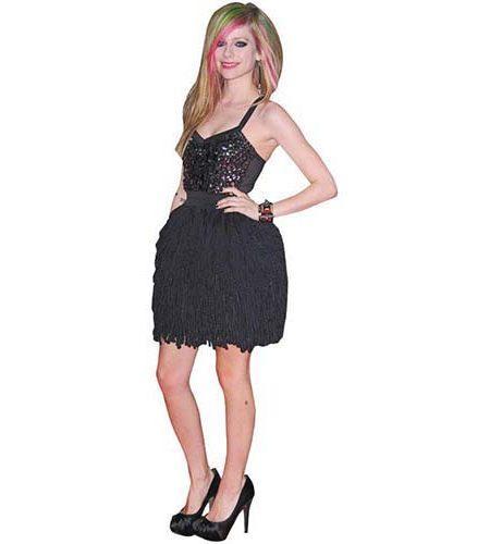 A Lifesize Cardboard Cutout of Avril Lavigne wearing a dress and heels