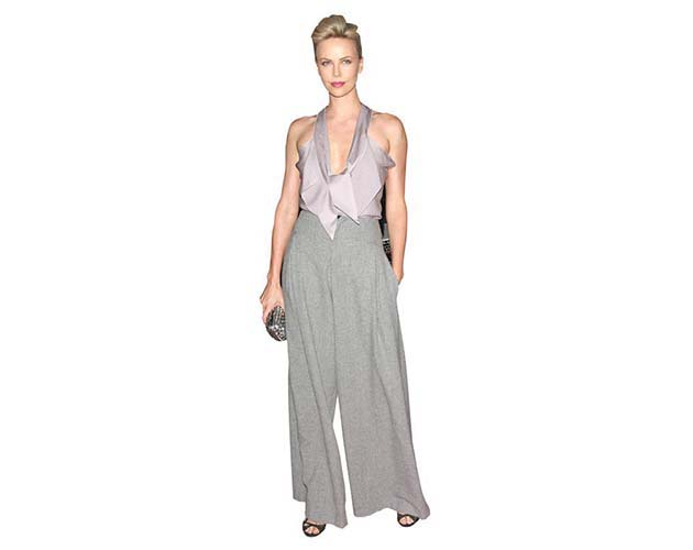 A Lifesize Cardboard Cutout of Charlize Theron wearing a trouser suit