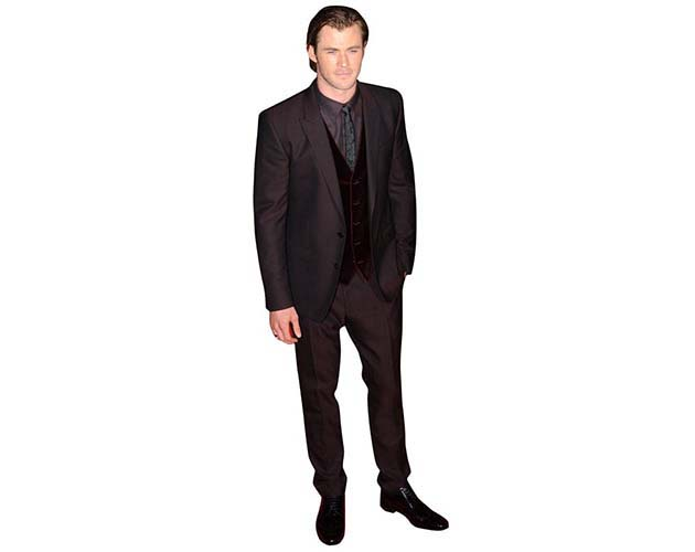 A Lifesize Cardboard Cutout of Chris Hemsworth wearing a dark suit