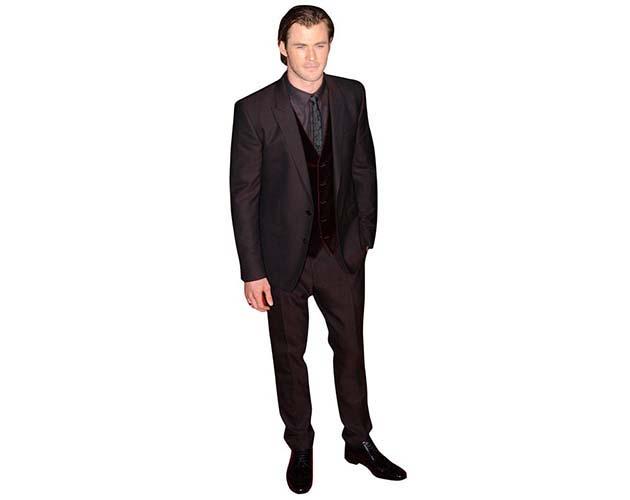 A Lifesize Cardboard Cutout of Chris Hemsworth wearing a dark suit