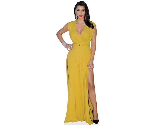 A Lifesize Cardboard Cutout of Kim Kardashian wearing a yellow gown
