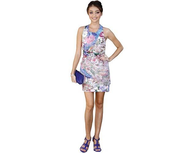 A Lifesize Cardboard Cutout of Sarah Hyland wearing a floral dress