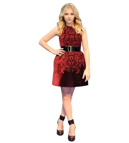 A Lifesize Cardboard Cutout of Chloe Moretz wearing a red dress