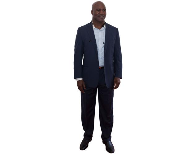 A Lifesize Cardboard Cutout of Evander Holyfield wearing a suit