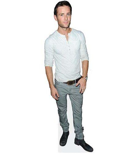 A Lifesize Cardboard Cutout of Harry Judd wearing jeans