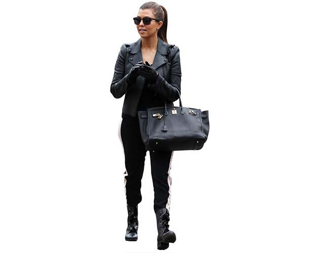 A Lifesize Cardboard Cutout of Kourtney Kardashian wearing leather