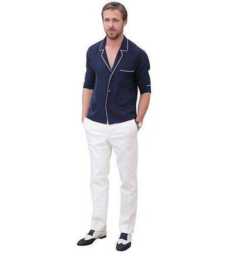 A Lifesize Cardboard Cutout of Ryan Gosling wearing white trousers