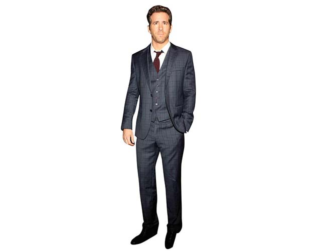 A Lifesize Cardboard Cutout of Ryan Reynolds wearing a three piece suit