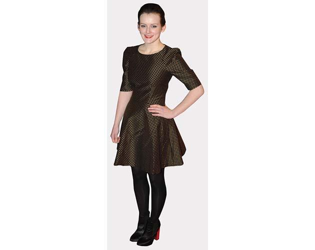 A Lifesize Cardboard Cutout of Sophie McShera wearing a dark outfit