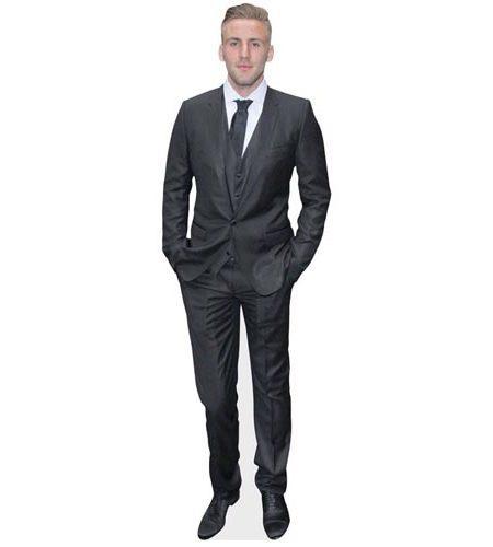 A Lifesize Cardboard Cutout of Luke Shaw wearing a grey suit