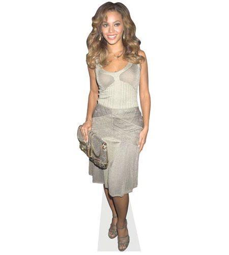 A Lifesize Cardboard Cutout of Beyonce Knowles wearing a silver dress