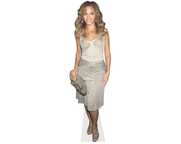 A Lifesize Cardboard Cutout of Beyonce Knowles wearing a silver dress