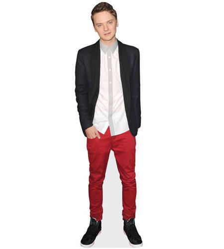 A Lifesize Cardboard Cutout of Conor Maynard wearing red trousers