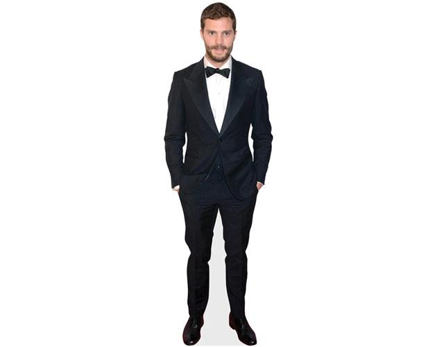 A Lifesize Cardboard Cutout of Jamie Dornan wearing a suit