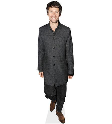 A Lifesize Cardboard Cutout of Jason Orange wearing a coat