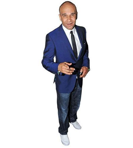 A Lifesize Cardboard Cutout of Goldie wearing a blue suit