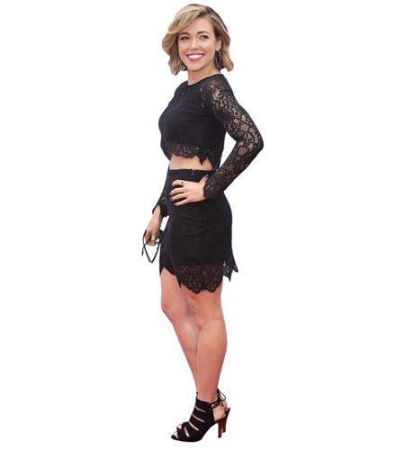 A Lifesize Cardboard Cutout of Rachel Platten wearing a dress
