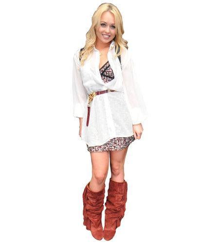 A Lifesize Cardboard Cutout of Jorgie Porter wearing boots