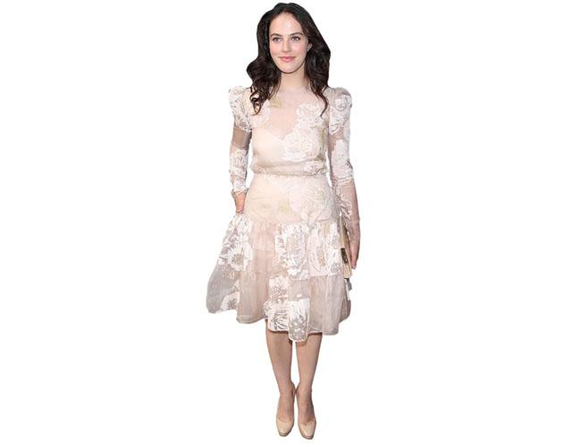 A Lifesize Cardboard Cutout of Jessica Brown Findlay wearing a dress